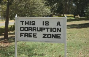 """Photo of a sign which reads """"This is a corruption free zone"""""""