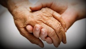 Photo of two hands clasped together